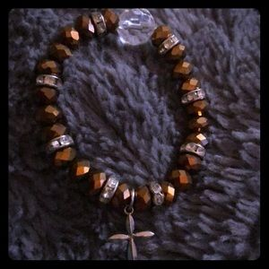 Bronze beaded and cross bracelet
